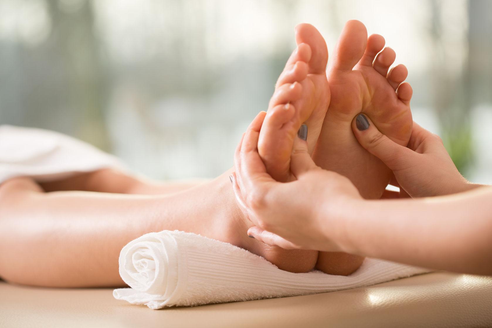 40342848-close-up-of-young-woman-having-reflexology-stock-photo-reflexology-feet-massage